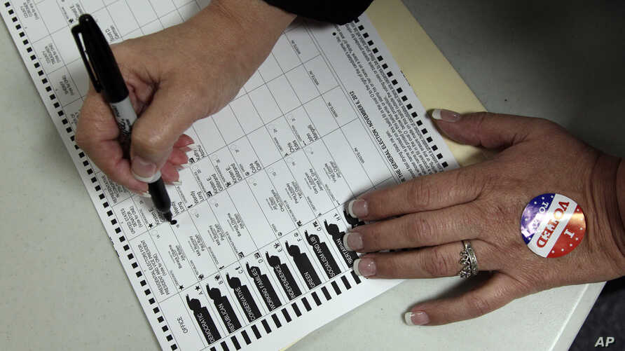 A voter, who did not wish to be identified, votes on Election Day at the Holland Land Office Museum in Batavia, N.Y., Tuesday, Nov. 6, 2012.