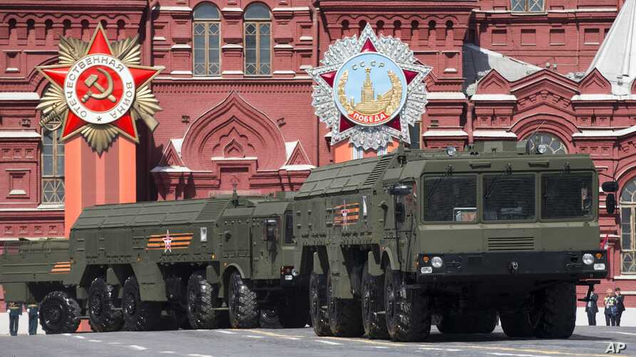 FILE - Iskander missile launchers are part of the Victory Parade marking the 70th anniversary of the defeat of the Nazis, in Red Square in Moscow, Russia, May 9, 2015. Russia airlifted its state-of-the art Iskander missiles to the Kaliningrad region