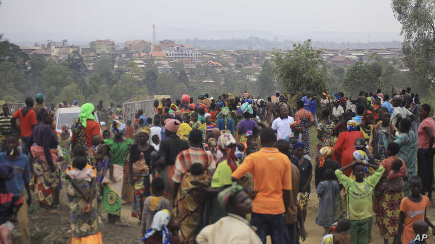FILE - People who fled from their homes following recently attacks by assailants take refuge at a camp for displaced people in Bunia, Eastern Congo, Feb. 17, 2018.