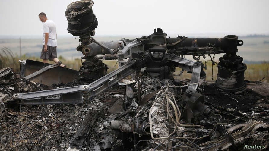Debris is pictured at the site of Thursday's Malaysia Airlines Boeing 777 plane crash, near the village of Grabovo in the Donetsk region July 18, 2014. World leaders demanded an international investigation into the shooting down of Malaysia Airlines