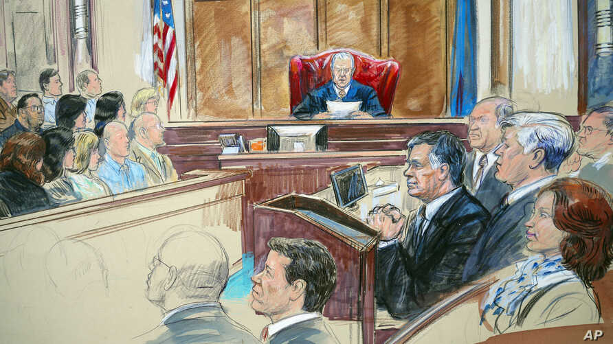 This courtroom sketch shows Paul Manafort listening to U.S. District Judge T.S. Ellis III at federal court in Alexandria, Va., Aug. 21, 2018, with a few of the jurors show at left.