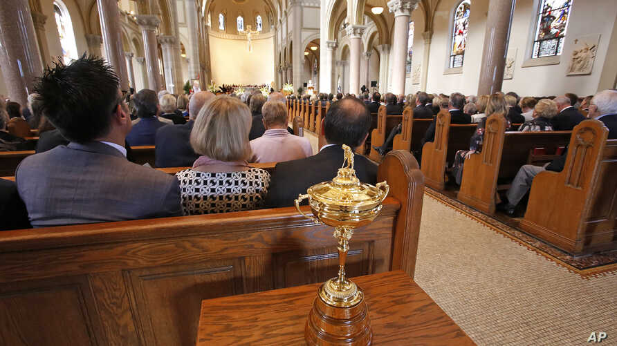 The Ryder Cup sits in the back of the Basilica at Saint Vincent College during a memorial service for golfer Arnold Palmer in Latrobe, Pennsylvania, Oct. 4, 2016.