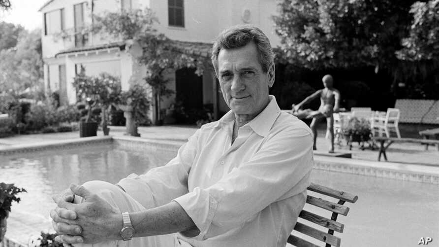 Actor Rock Hudson poses by the swimming pool in his backyard at home in Hollywood, Ca., Nov. 8, 1984.  (AP Photo/Wally Fong)