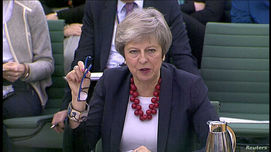 A still image from video footage shows Britain's Prime Minister Theresa May speaking at a Select Committee hearing, in London, Nov. 29, 2018.