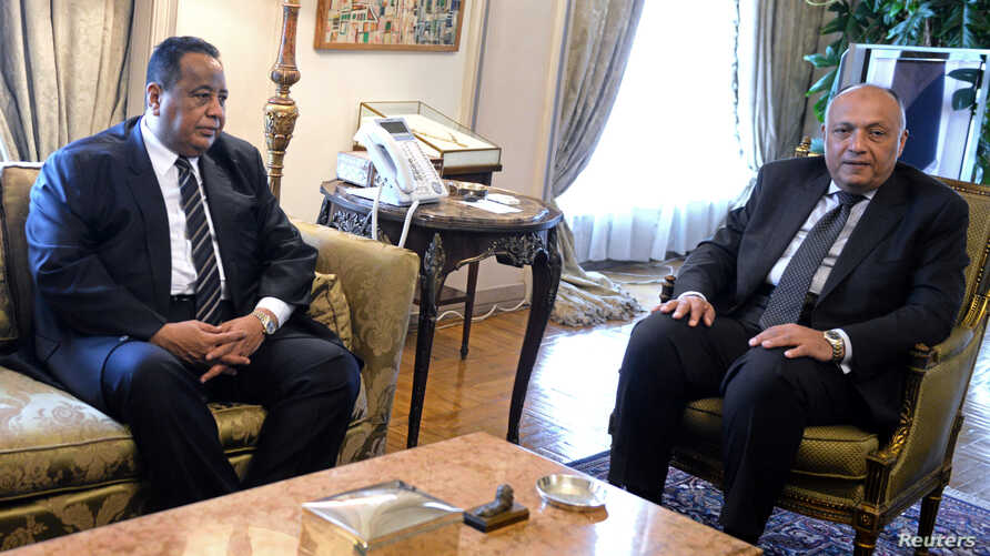 Egypt's Foreign Minister Sameh Shoukry (R) is pictured during a meeting with his Sudanese counterpart Ibrahim Ghandour in Cairo, Egypt, June 3, 2017.