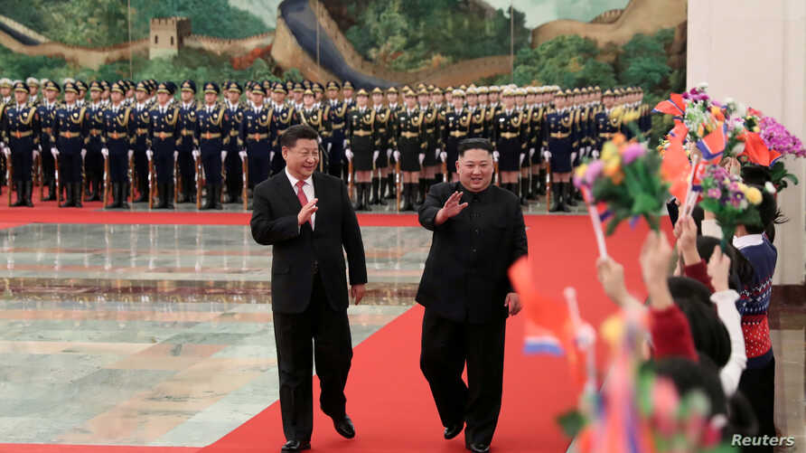 Chinese President Xi Jinping holds a welcoming ceremony for North Korean leader Kim Jong Un before their talks at the Great Hall of the People in Beijing, Jan. 8, 2019, in this picture released by Xinhua, Jan. 10, 2019.