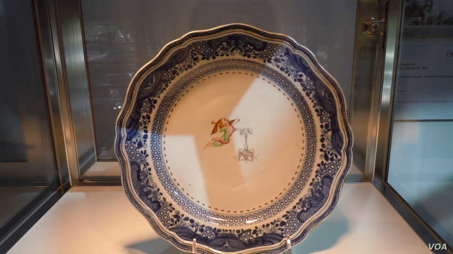 porcelain which was made to order in China for President George Washington and his wife Martha. This on plate is expected to sell at auction for between $25,000 and $40,000. (VOA/J. Taboh)