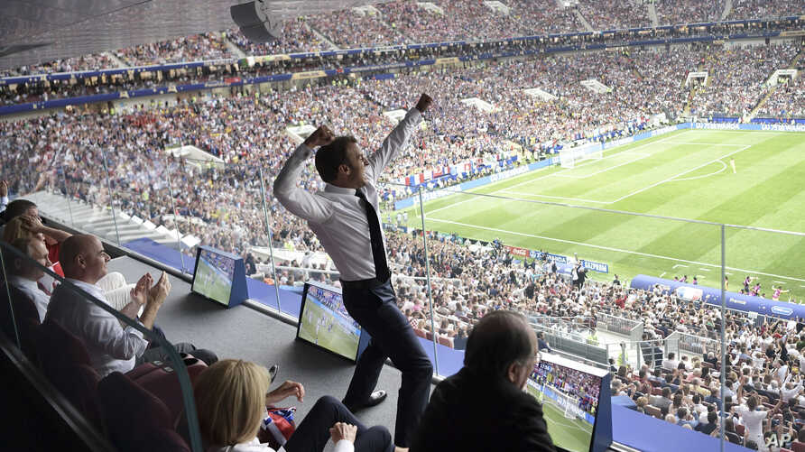 French President Emmanuel Macron reacts during the final match between France and Croatia at the 2018 soccer World Cup in the Luzhniki Stadium in Moscow, July 15, 2018.