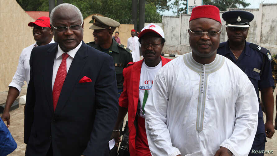 """FILE - Sierra Leonean Vice President Samuel Sam-Sumana, shown in Freetown in October 2012, says he's feeling well but """"decided to be put under quarantine because I do not want to take chances."""""""