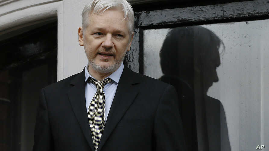 FILE - WikiLeaks founder Julian Assange speaks from the balcony of the Ecuadorean embassy in London, Feb. 5, 2016. Assange was interviewed about Swedish sex crime allegations at the embassy on Monday, Nov. 14, 2016.