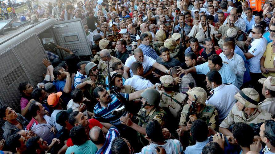 Egyptian Army soldiers respond to clashes between supporters and opponents of ousted President Mohammed Morsi in Alexandria, Egypt, Friday, Sept. 13, 2013.