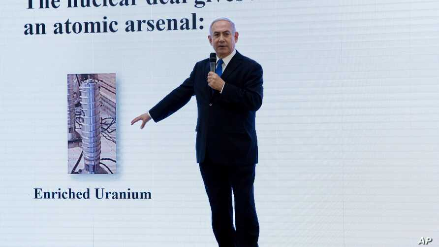 """FILE - Israeli Prime Minister Benjamin Netanyahu presents material on Iranian nuclear weapons development during a press conference in Tel Aviv, April 30 2018. Netanyahu said his government had obtained """"half a ton"""" of secret Iranian documents provin"""