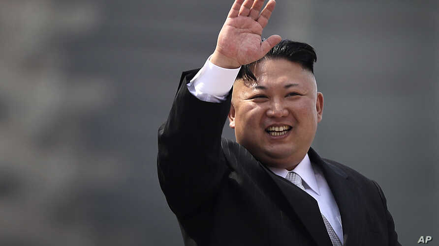 North Korean leader Kim Jong Un waves during a military parade in Pyongyang, North Korea, to celebrate the 105th birth anniversary of Kim Il Sung, the country's late founder and grandfather of current ruler Kim Jong Un, April 15, 2017. (