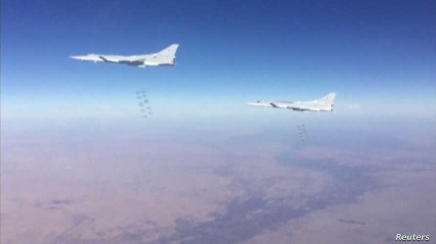 A still image taken from a video footage and released by Russia's Defence Ministry on January 24, 2017, shows Russian Tupolev Tu-22M3 long-range bombers dropping off bombs on what Defense Ministry said Islamic State targets in Deir al-Zor province, S