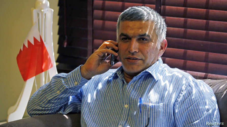 Bahrain human rights activist Nabeel Rajab talks on his mobile phone upon arriving home in Budaiya, west of Manama, after being detained for over two weeks, May 28, 2012.
