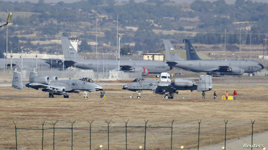 U.S. Air Force A-10 Thunderbolt II fighter jets (foreground) are pictured at Incirlik airbase in the southern city of Adana, Turkey, Dec. 11, 2015.