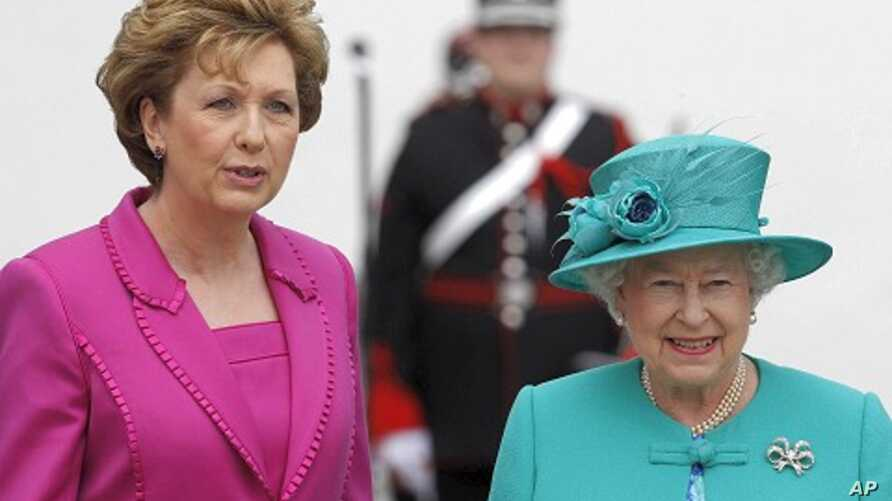 Ireland's President Mary McAleese welcomes Britain's Queen Elizabeth at her residence in Dublin, May 17, 2011