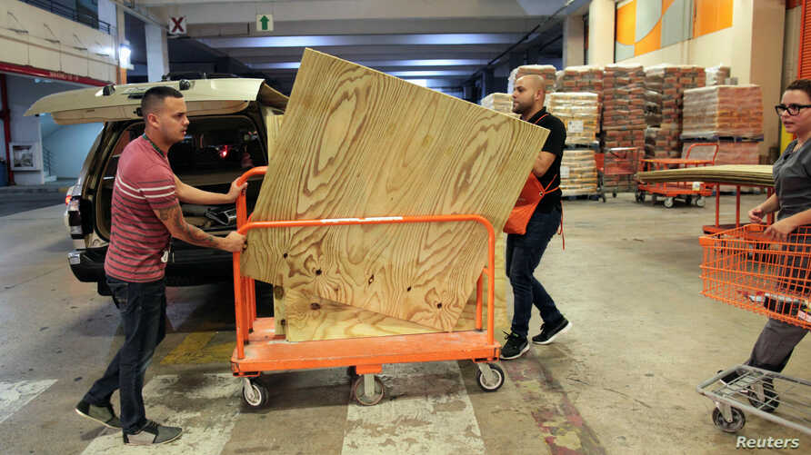 People buy materials at a hardware store after Puerto Rico Governor Ricardo Rossello declared a state of emergency in preparation for Hurricane Irma, in Bayamon, Puerto Rico, Sept. 4, 2017.