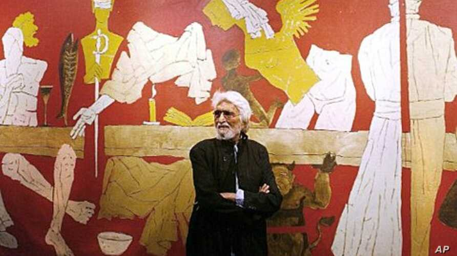 Indian artist Maqbool Fida Husain stands against one of his paintings titled 'Last Supper' at the opening of his exhibition '...and not only 88 of Hussain' at the National Art Gallery in Mumbai.