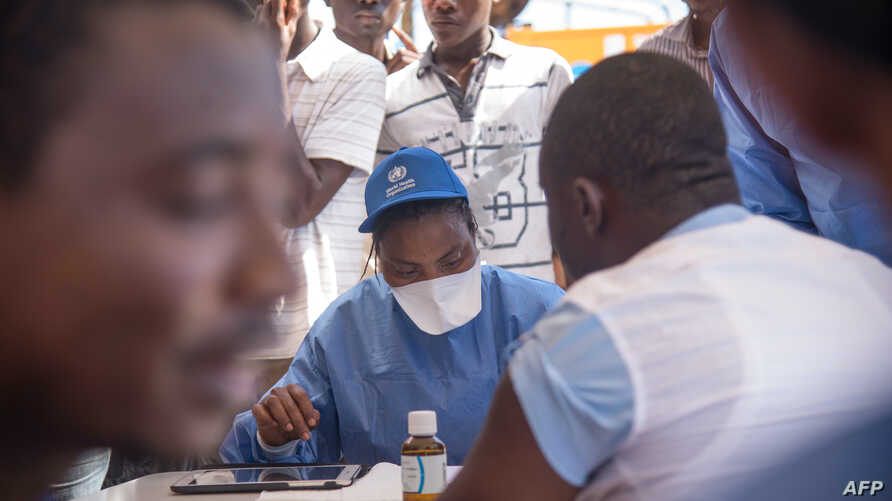 Nurses working with the World Health Organization (WHO) prepare to administer vaccines at the town all of Mbandaka on May 21, 2018 during the launch of the Ebola vaccination campaign.