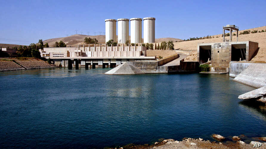 "FILE - A general view of the dam in Mosul, 360 kilometers (225 miles) northwest of Baghdad, Iraq. U.S. engineers examining the dam say they have found new signs of distress in the massive structure and it is now at ""significantly higher risk"" of fail"
