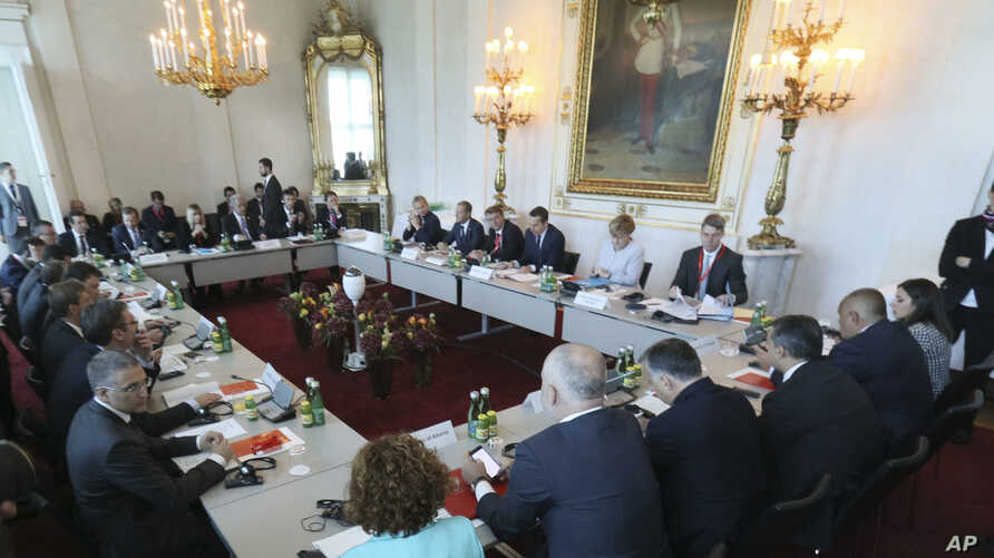 Austrian Chancellor Christian Kern (C) opens a meeting with his German and West Balkans counterparts on strategies to deal with Europe's migrant crisis, in Vienna, Austria, Sept. 24, 2016.