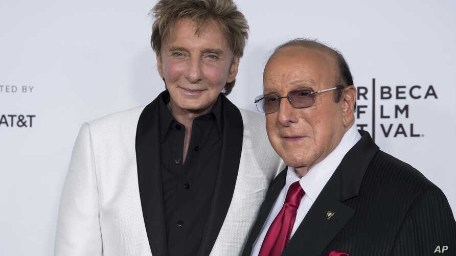 "Barry Manilow, left, and Clive Davis attend the world premiere of ""Clive Davis: The Soundtrack of Our Lives"" at Radio City Music Hall, during the 2017 Tribeca Film Festival, April 19, 2017, in New York."