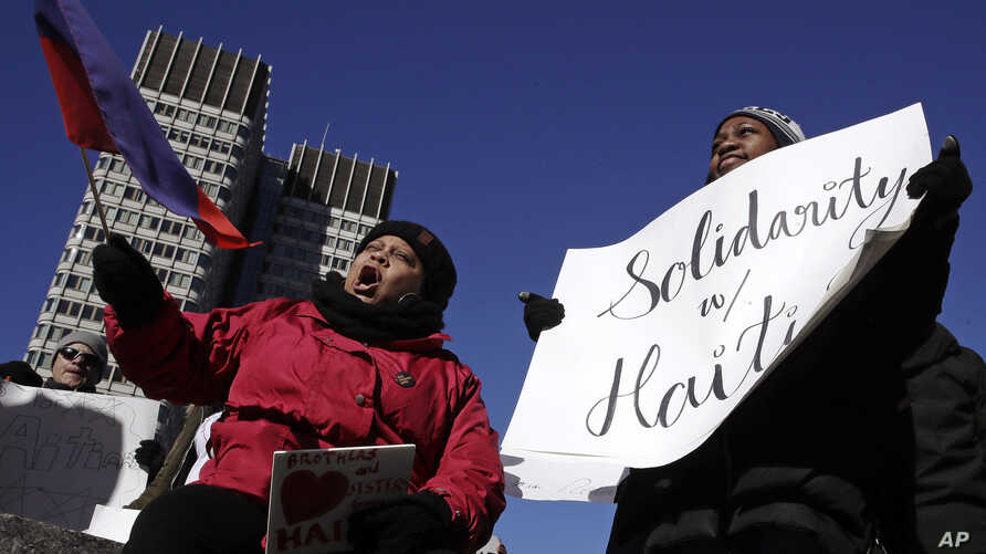 Haitian activists and immigrants protest on City Hall Plaza in Boston, Jan. 26, 2018. Haitian community leaders had complained that the Trump administration's delays in re-registering those living in the U.S. legally through the Temporary Protected S