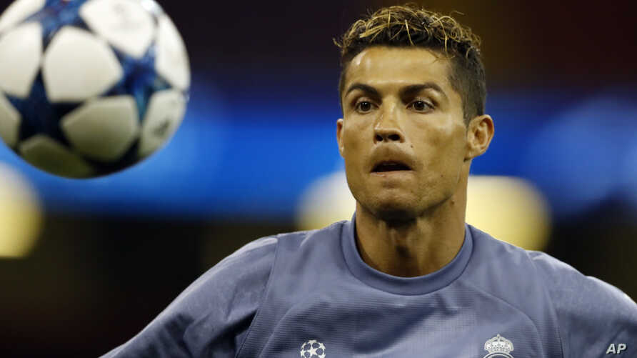 Real Madrid's Cristiano Ronaldo watches the ball during a training session at the Millennium Stadium in Cardiff, Wales Friday June 2, 2017. Real Madrid will play Juventus in the final of the Champions League soccer match in Cardiff on Saturday. (AP P