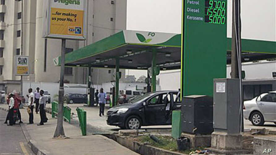 A gas station displays the price for fuel at a petrol station in Lagos, Nigeria, January 17, 2012.