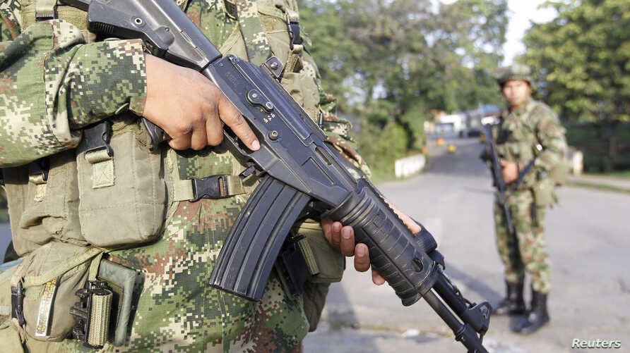 Colombian soldiers stand guard on a street in Caloto, Columbia, Feb. 6, 2014.