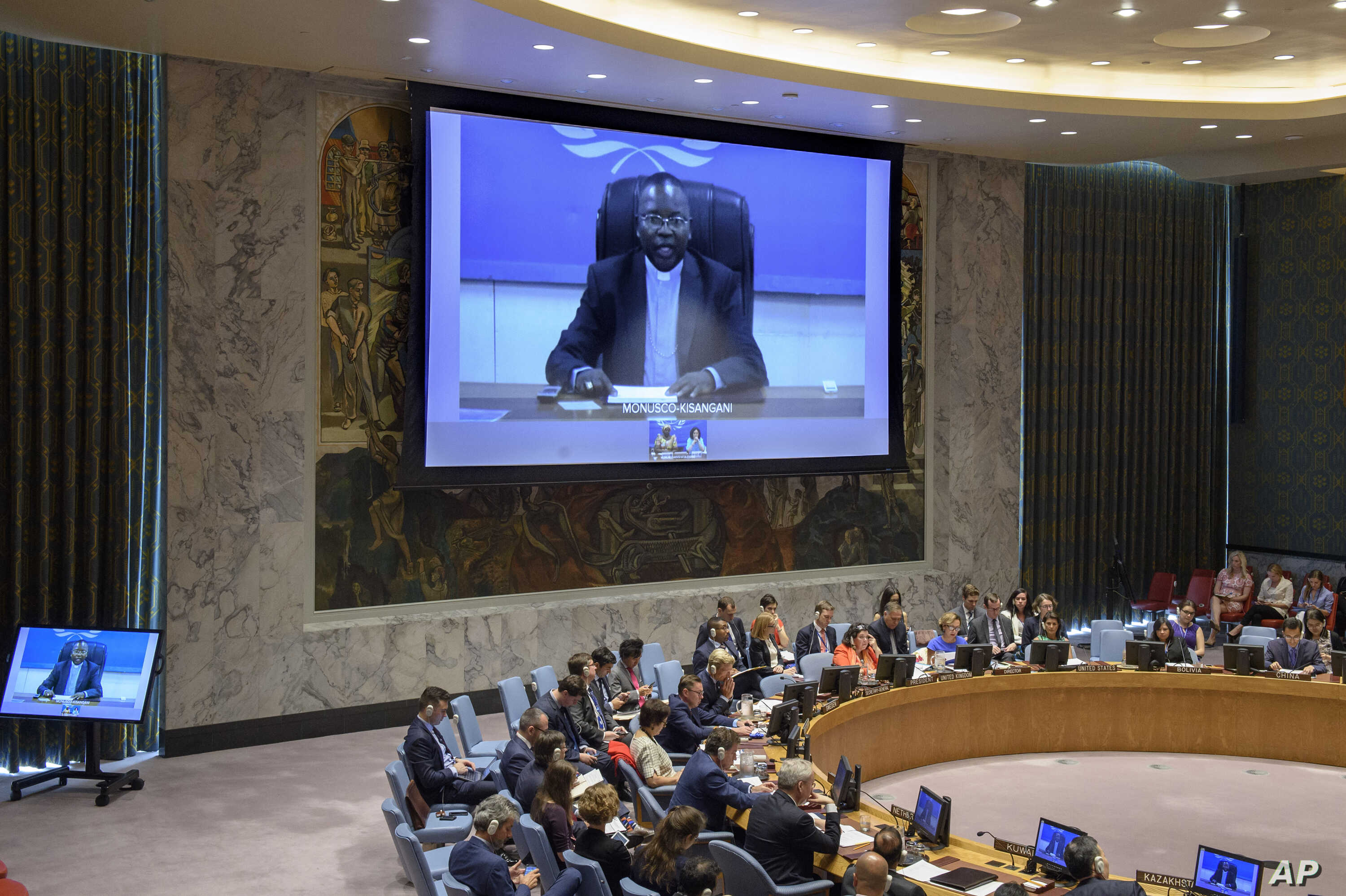 In this UN photo, Marcel Utembi, on screen, president of the National Episcopal Conference of the Congo, addresses the Security Council on the situation concerning the Democratic Republic of the Congo.