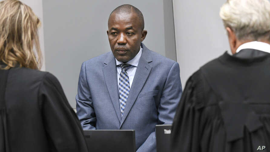 Alfred Yekatom, center, a Central African Republic lawmaker and militia leader who goes by the nickname Rambo, appears before the International Criminal Court, ICC, in The Hague, Netherlands, Nov. 23, 2018.