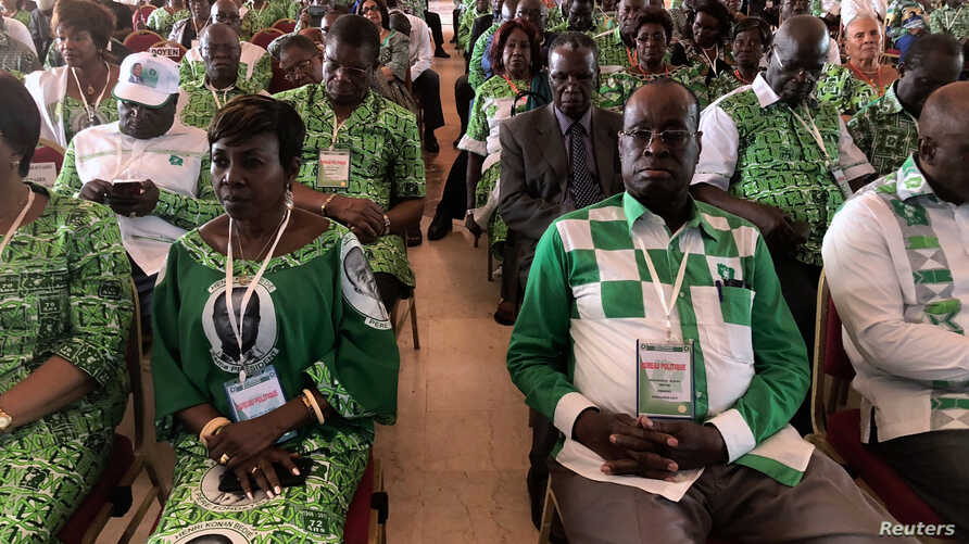 Members of PDCI (Democratic party of the Ivory Coast) attend a meeting, in Daoukro, Ivory Coast, Sept. 24, 2018.
