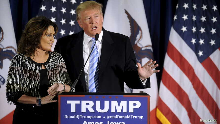 FILE -  US Republican presidential candidate Donald Trump (R) thanks the crowd after receiving Former Alaska Gov. Sarah Palin's endorsement at a rally at Iowa State University in Ames, Iowa Jan. 19, 2016.