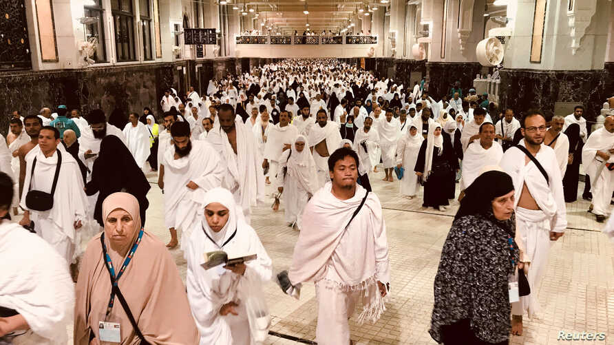 Muslim pilgrims walk in the Al-Safa direction (Safa and Marwah) where Muslims walk back and forth seven times during Tawaf al- Ifada as part of  the annual haj pilgrimage rite at the grand Mosque in the holy city of Mecca , Saudi Arabia, Aug. 21, 201