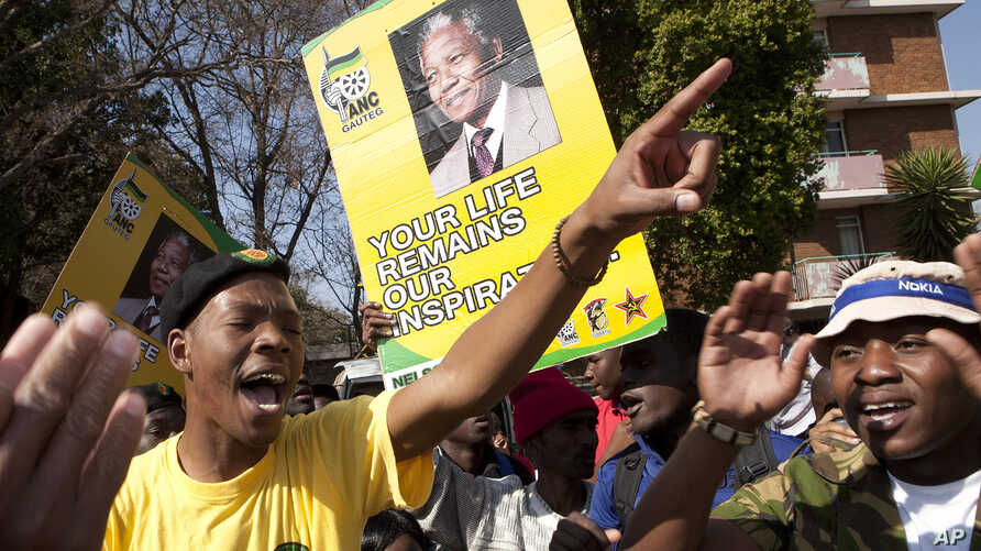 Members of the ruling party youth league sing outside the Mediclinic Heart Hospital where former South African President Nelson Mandela was being treated in Pretoria, South Africa, July 17, 2013.