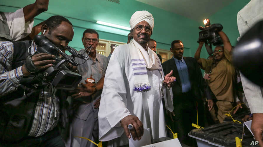 President Omar al-Bashir casts his ballot as he runs for another term, on the first day of the presidential and legislative elections, in Khartoum, Sudan, April 13, 2015.