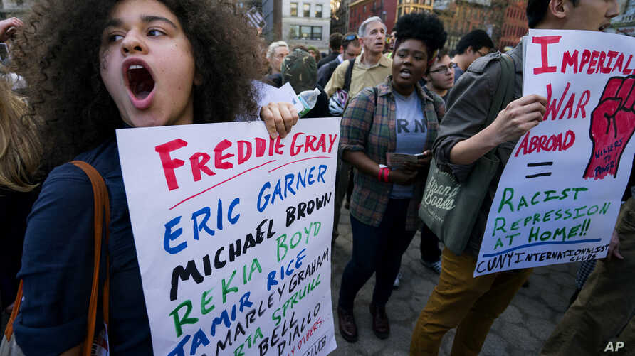 Protesters yell out in Union Square Wednesday, April 29, 2015, in New York. People gathered to protest the death of Freddie Gray, a Baltimore man who was critically injured in police custody. (AP Photo/Craig Ruttle)