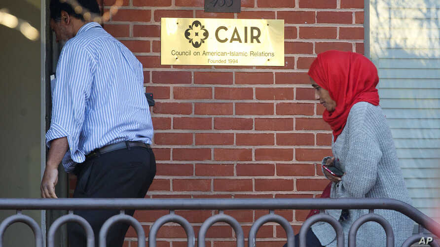 People enter the headquarters of Council on American-Islamic Relations (CAIR) in Washington, Dec. 10, 2015. CAIR helped Shaima Swileh, a Muslim in Yemen, win a legal battle that will allow her to see her son, who is on life support in San Francisco.