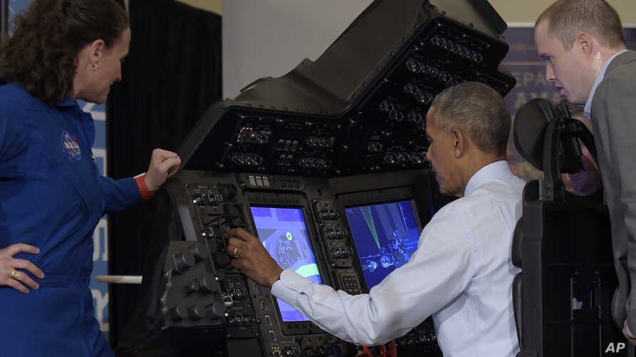 President Barack Obama sits in a flight simulator during a tour of innovation projects at the White House Frontiers Conference at University of Pittsburgh in Pittsburgh, Pennsylvania, Oct. 13, 2016.
