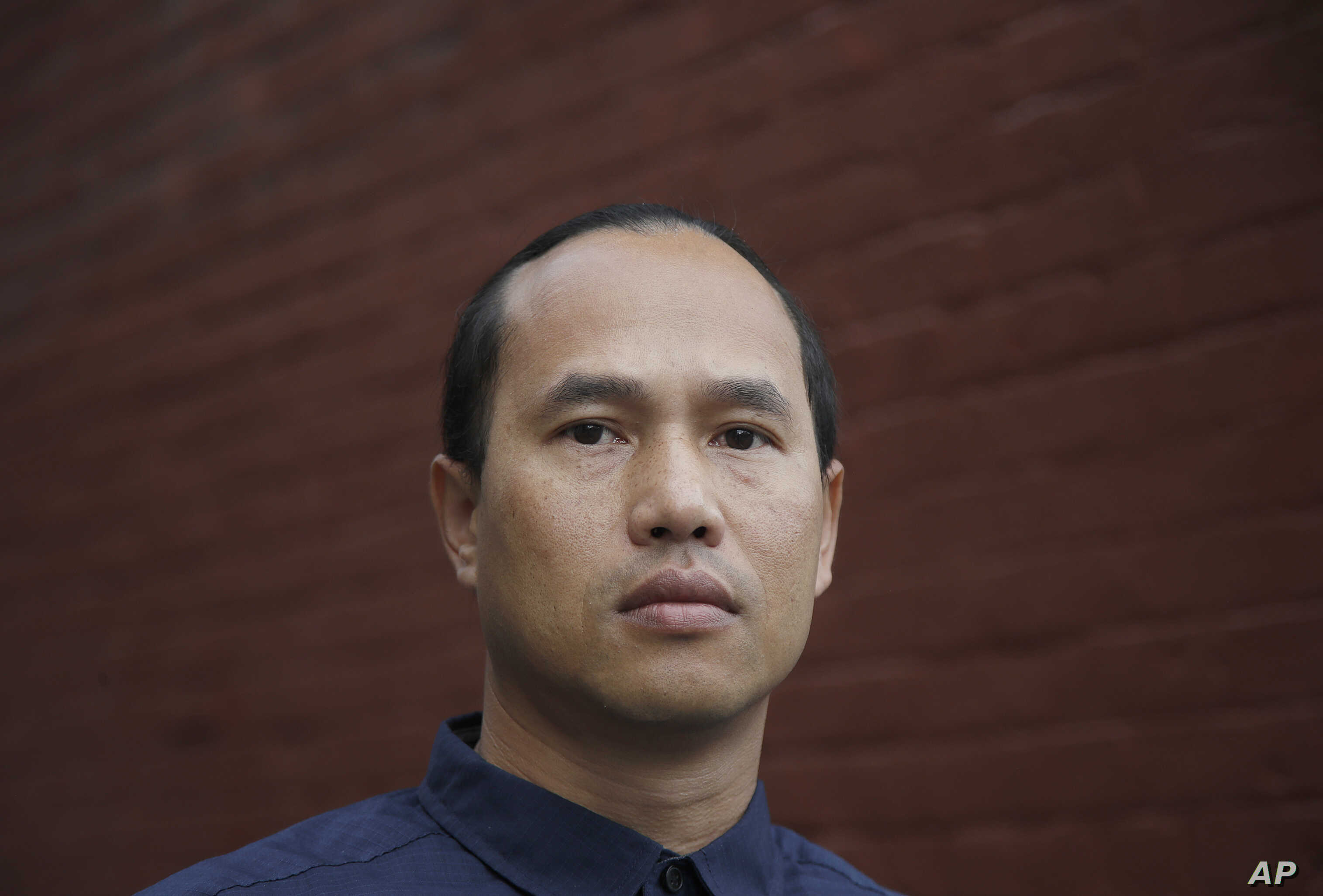 FILE - Borey Ai served 19 years in prison before parole officials decided he'd turned his life around and he walked out of San Quentin and into federal immigration agents. The California Supreme Court has blocked Gov. Jerry Brown's pardon of the 37-y