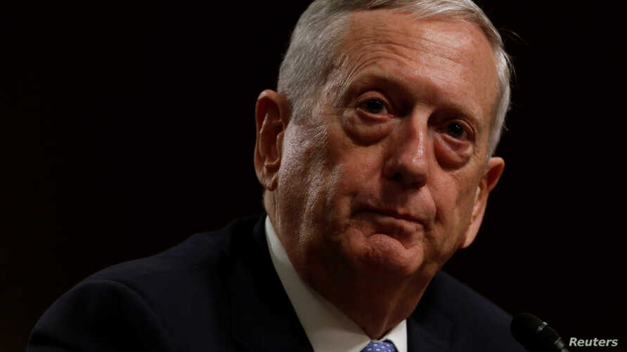 "FILE - Retired U.S. Marine Corps General James Mattis, shown at his confirmation hearing before the Senate Armed Services Committee on Jan. 12, 2017, told Defense Department staff and service members worldwide that they represent ""an America that rem"