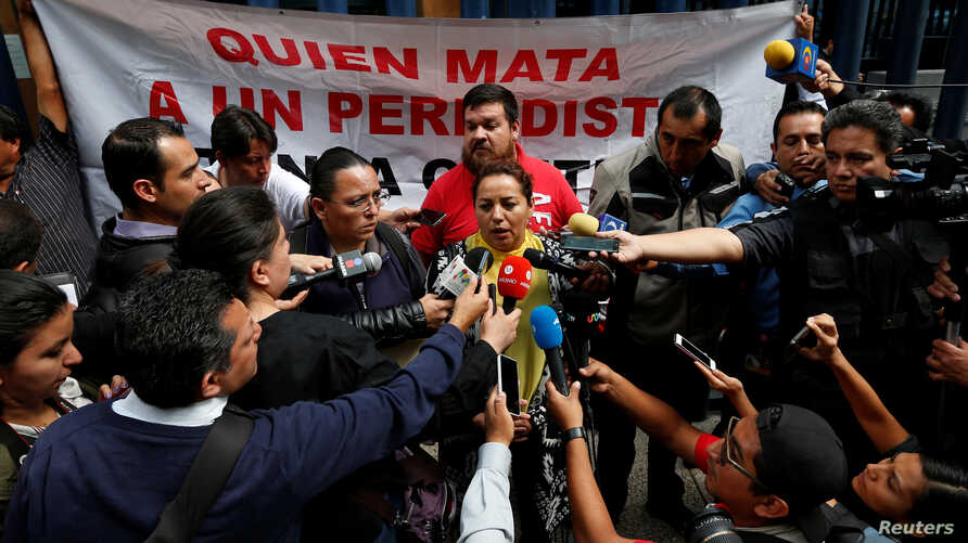 FILE - Frida Ortiz, wife of reporter Salvador Adame, speaks to the media during a protest against the May 18 disappearance of Adame, outside the offices of the Attorney General of the Republic in Mexico City, Mexico, June 1, 2017.