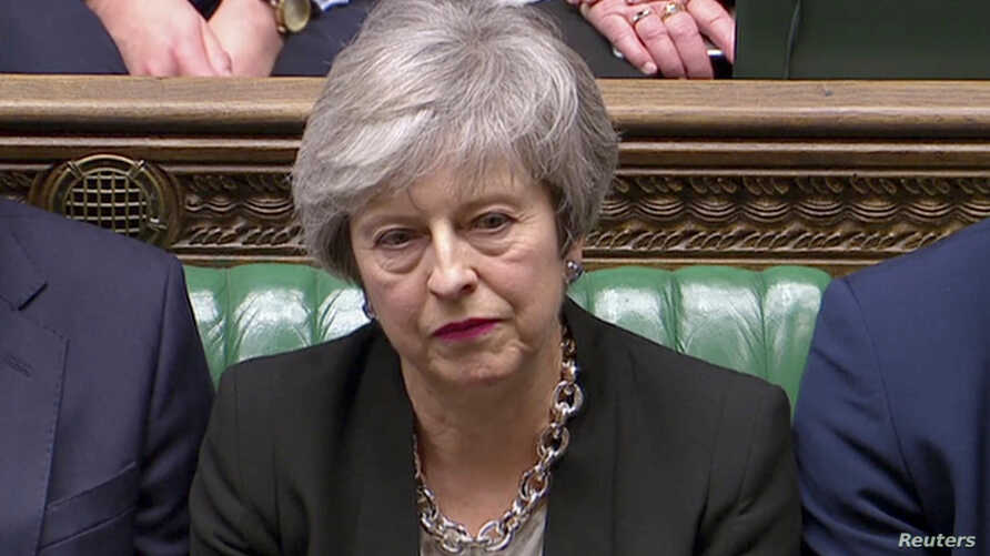 Britain's Prime Minister Theresa May listens as Jeremy Corbyn speaks in Parliament, London, Jan. 29, 2019.