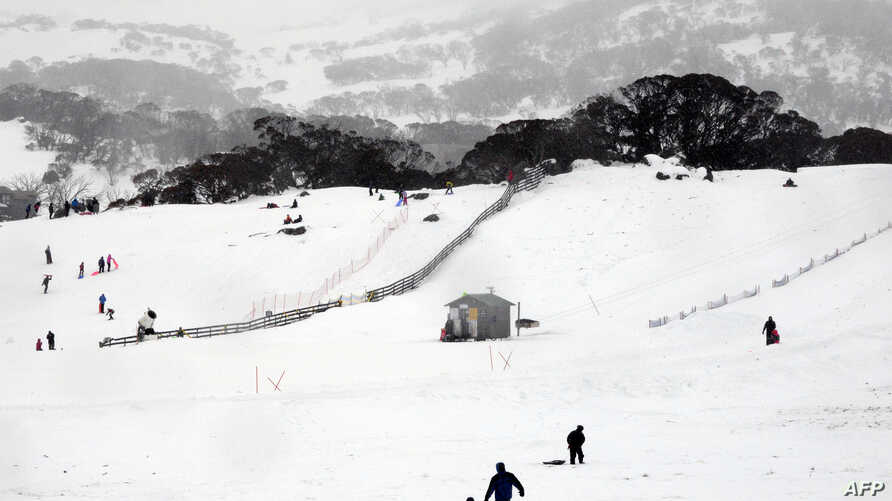 FILE - This picture taken Aug. 1, 2015, shows skiers and snowboarders at Perisher Valley in the Snowy Mountains of southern New South Wales.
