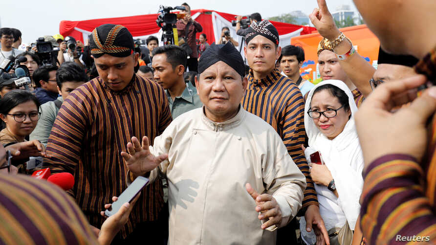 FILE - Prabowo Subianto, challenger to incumbent President Joko Widodo, leaves a ceremony marking the start of the campaigning period for next year's election in Jakarta, Indonesia, Sept. 23, 2018.