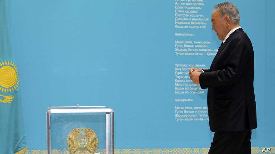 Kazakhstan's President and the main presidential candidate Nursultan Nazarbayev walks to casts his ballot at a polling station in Astana, the capital of Kazakhstan, Sunday, April 26, 2015.