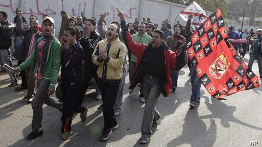 Fans from Al Ahly and Al Zamalek soccer teams chant slogans against the violence that occurred during a soccer match involving Al Ahly in Port Said, February 2, 2012