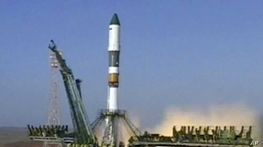 In this image made from Rossiya 24 television channel a Soyuz rocket booster carrying Progress supply ship is launched from the Baikonur cosmodrome in Kazakhstan. (File Photo - August 24, 2011)